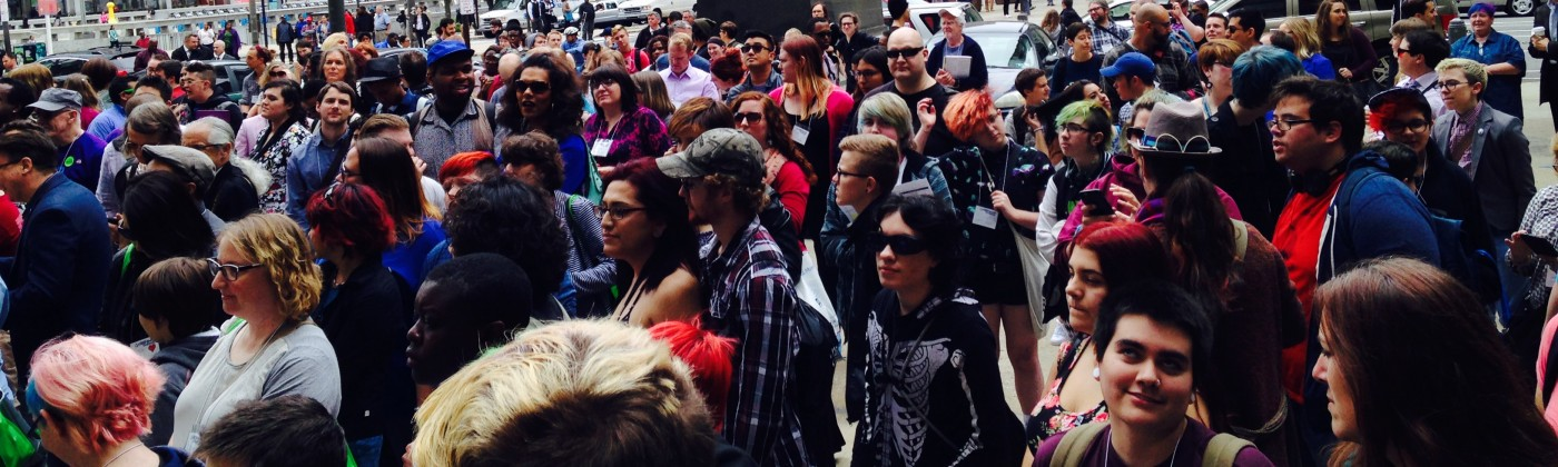 A crowd gathering for the flying of the transgender flag in Philadelphia, PA